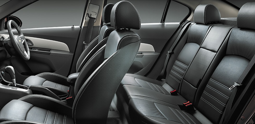 Luxurious jet black interiors with titanium stitching.